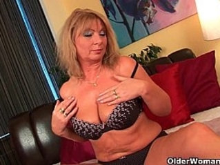 Grandma with her big tits finger fucks her oiled pussy