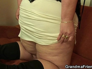 Plump mommy takes young cocks