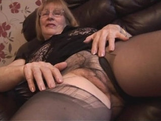 Busty amateur blonde granny rips pantyhose to show off hairy pussy