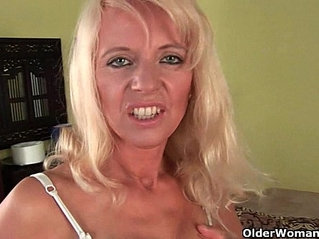 Sultry senior mom probes her old pussy and ass with large dildo